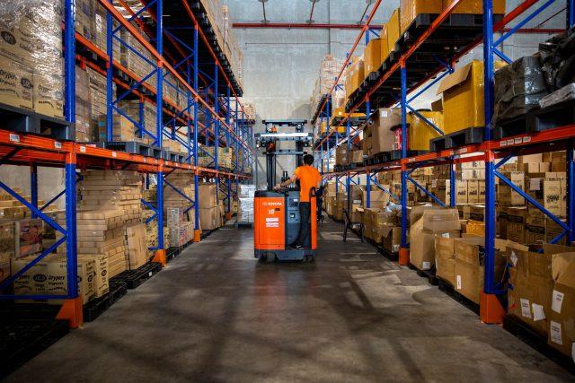 Man going through warehouse. | Source: Shopee
