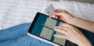 Woman using tablet for online transfer of funds.   Photo by Tima Miroshnichenko from Pexels